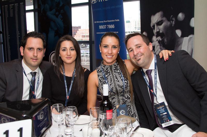 Essendon Hyundai's Andrew Caruso (far left) with wife Daniella & Justin Smith with wife Tegan